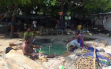 Men preparing fish traps